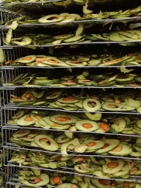 The whole avocado fruit is washed, sliced and left to dry.